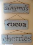almonds cocoa cherries wooden signs